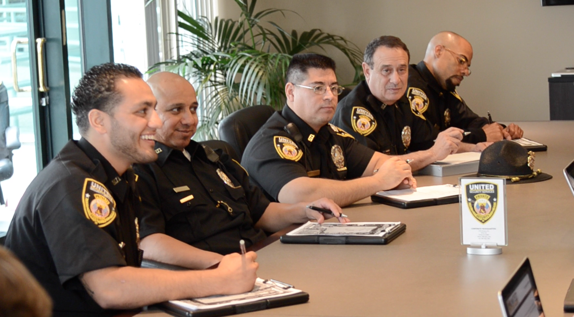 Officers in a meeting with managers - United HQ Conference Room
